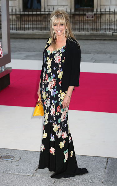 Arriving at an art exhibition on London, Jo Wood posed for a picture in her sweet floral print gown.