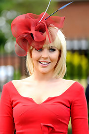 Lydia Bright looked stunning in a red mesh fascinator at the Royal Ascot 2012.