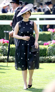 Princess Eugenie paired her LBD with a black envelope clutch.