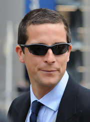 Bear Grylls looked formal in a suit, but he still had that athletic vibe thanks to his half jacket sunglasses.