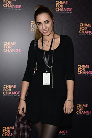 IT girl Amber Le Bon arrived at the 'Chime for Change' concert in a black knit dress.
