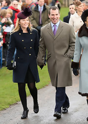 Autumn Phillips looked stately wearing a blue gold button pea coat to attend Christmas Day service at Sandringham.