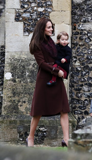 Kate Middleton was winter-glam in a maroon fur-lapel coat by Hobbs while attending church on Christmas day.