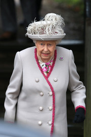 Queen Elizabeth II complemented her coat with a gray feather hat for Christmas Day church service.