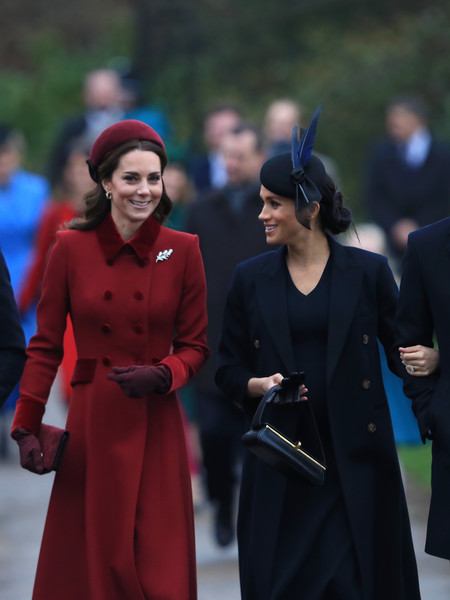 Meghan Markle headed to Christmas Day church service carrying a midnight-blue leather purse by Victoria Beckham.