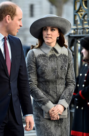 Kate Middleton arrived for the Commonwealth Observance Day service wearing a gray wide-brimmed hat by John Boyd.