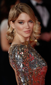 Lea Seydoux was glamorously coiffed with vintage-style curls at the royal film performance of 'Spectre.'