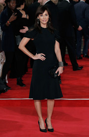 Natalie Imbruglia donned a little black dress with draped sleeves and a fluted hem for the royal film performance of 'Spectre.'