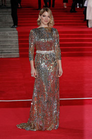 Lea Seydoux absolutely stunned in a fully sequined gold gown by Prada at the royal film performance of 'Spectre.'