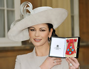 Talk about British elegance! Catherine donned a decorative linen hat to wear with her Michael Kors dress and blazer.