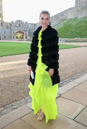 Arizona Muse amped up the luxe factor (and toned down her bright gown) with a black fur coat during the Royal Marsden celebration.