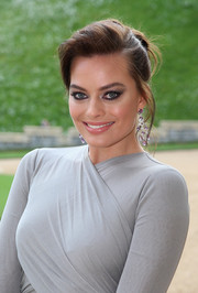 Margot Robbie wore her hair in an elegant loose side-parted bun during the Royal Marsden celebration.