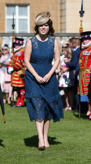 Princess Eugenie kept it prim and proper in a blue lace midi dress by Whistles at the Royal Society for the Prevention of Accidents Centenary Garden Party.