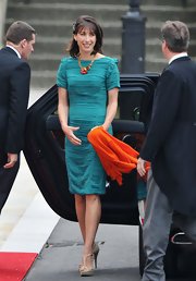 Samantha Cameron looked chic in a vibrant turquoise cocktail dress with bold orange accessories for the royal wedding.