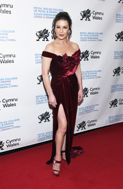 Catherine Zeta-Jones looked ultra elegant in a red velvet off-the-shoulder gown by Marchesa at the Royal Welsh College of Music and Drama Gala.