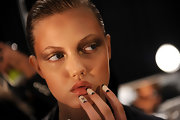 Lindsey's gold and bronze eyeshadow gave a nymph-like earthy look to her Ruffian runway look.