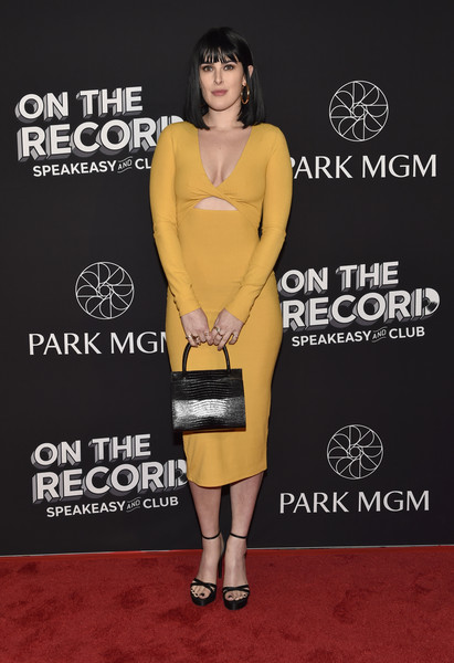 Rumer Willis Snakeskin Purse [on the record,clothing,yellow,dress,premiere,cocktail dress,carpet,footwear,leg,red carpet,flooring,rumer willis,speakeasy and club red carpet grand opening celebration at park mgm,las vegas,nevada,park mgm,opening,celebration,on the record speakeasy and club]