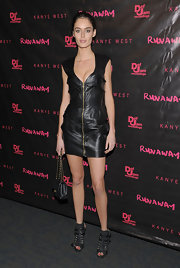 Nicole ramped up her edge factor with a leather clad zip up dress. She paired her look with buckled ankle boots.