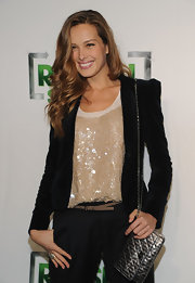 Petra is all smiles in this darling black velvet blazer and sequined top.