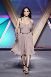 Michelle Rodriguez walked the Fashion for Relief runway looking elegant in a pleated cocktail dress with metallic trim.