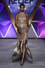 Maria Borges looked ravishing in a sheer gold halter dress with a fringed hem at the Fashion for Relief runway show.