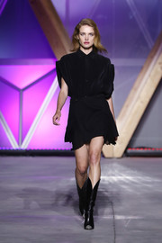 Natalia Vodianova was relaxed yet chic in a black mini shirtdress at the Fashion for Relief runway show.