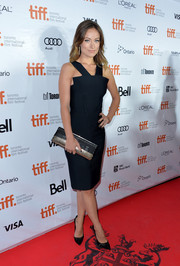 Olivia Wilde worked the 'Rush' red carpet in a Roland Mouret LBD with a geometric neckline.