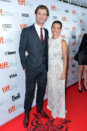 Elsa Pataky accompanied hubby Chris Hemsworth to the  premiere of 'Rush' wearing a stunning white Elie Saab evening dress.