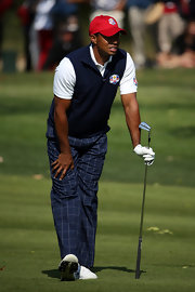 It really only seems fitting that Tiger Wood wear plaid slacks while playing golf!