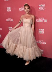 Lady Gaga looked uncharacteristically understated in a strapless nude corset gown by Dior Couture at the Patron of the Artists Awards.