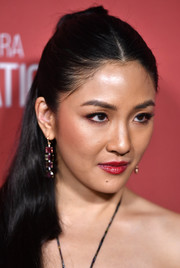 Constance Wu paired red lipstick with subtle eye makeup for the 2019 Patron of the Artists Awards.