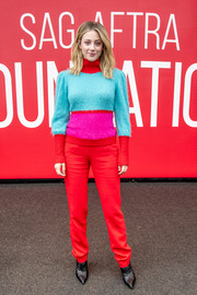 Lili Reinhart showed off her colorful winter style with this red, blue, and fuchsia turtleneck at the SAG-AFTRA Foundation Conversation: 'Hustlers.'