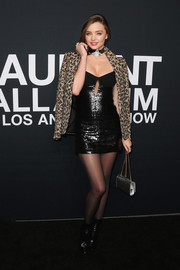 Miranda Kerr tempered the sexiness with a leopard-print blazer, also by Saint Laurent.