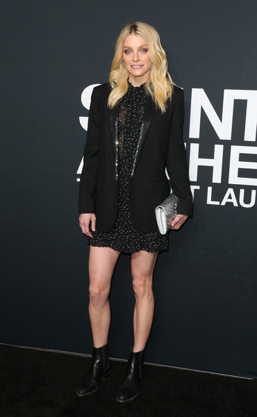 Jessica Stam toughened up her printed mini dress with a black boyfriend blazer for the Saint Laurent show.