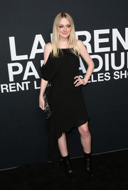 Dakota Fanning attended the Saint Laurent show wearing a drapey asymmetrcial LBD.