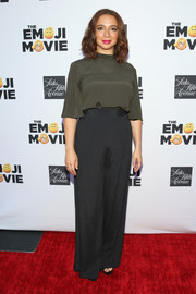 Maya Rudolph attended the Saks Fifth Avenue exclusive collection launch wearing a simple yet chic gray silk blouse.