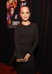 Mena Suvari paired a black zip-around clutch with a cutout dress for the premiere of 'Shot! The Psycho-Spiritual Mantra of Rock.'