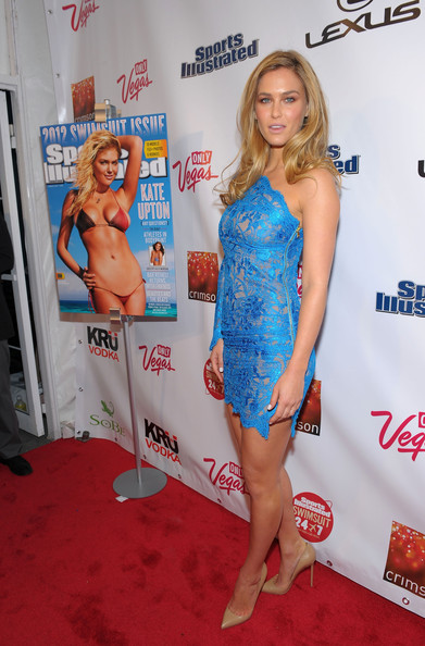 Bar kept her look simple, wearing nude stilettos with a blue lace mini dress.