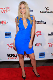 Genevieve Morton topped off her brilliant blue dress with cap-toe pumps.