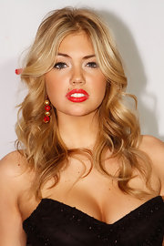 Kate Upton opted for a classic look at the Sports Illustrated launch party wearing timeless red lipstick.