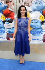 Katy appropriately donned blue at the premiere of 'The Smurfs 2' when she wore this cobalt blue beaded and floral dress that featured a flared leather skirt.
