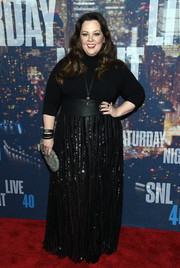 For a more glamorous finish, Melissa McCarthy teamed her turtleneck with a sparkly black maxi skirt, also from her own line.