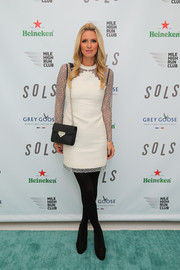 Nicky Hilton looked very polished in a little white dress with silver mesh sleeves during a SOLS event in New York City.