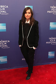 Ellen chose a sleek black blazer with white piping for her red carpet look at the Sony and Quantic Dream event.