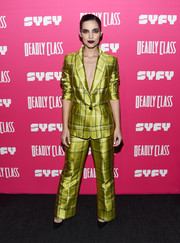 Maria Gabriela de Faria looked cool in a grid-patterned chartreuse pantsuit at the premiere of 'Deadly Class.'