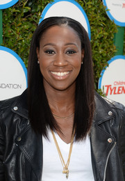Tina Charles kept it simple and sleek with this straight hairstyle during Safe Kids Day.