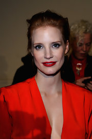 Jessica Chastain's red lips were glamorous, elegant and totally hot for the Saint Laurent fashion show in Paris.