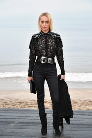 Amber Valletta looked sultry in a sheer black lace top by Saint Laurent during the brand's Men's Spring '20 show.