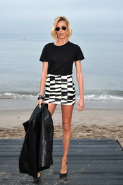 Anja Rubik kept it casual in a black tee at the Saint Laurent Men's Spring '20 show.