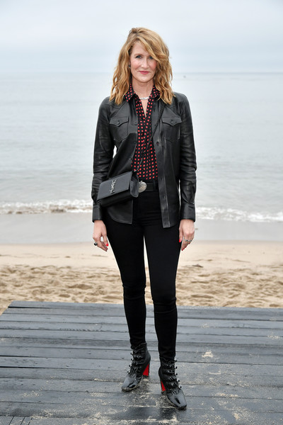 Laura Dern styled her look with military-inspired ankle boots by Christian Louboutin.